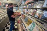 Scott Hoats from Emmaus, was the first customer at Soundcheck Records when the store reopened under the State's yellow classification.