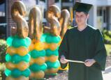 CCTI graduate Kyle Ketchledge walks with his diploma during the school's walk-through gradution ceremony.