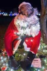 A Santa rat in a martial arts gi adorns the Rat Pack Family Fitness tree.