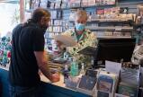 Trooper Pompa, owner of Soundcheck Records in Downtown Jim Thorpe rings up Scott Hoats Friday morning. Hoats, from Emmaus, was the first customer when the store reopened under the State's yellow classification.