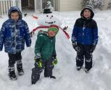 Matthew, Max and Mark Dematto of Summit Hill took advantage of the snowy day to make their happy snowman.By Trish Dematto