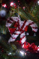 """Candy canes hang on the tree honoring all military members. """"Past, present and future."""""""
