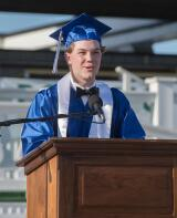 Class President Mitchell Hourt welcomes guests to Palmerton 2020 commencement exercise at Pocono Raceway.