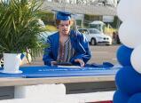 Carson Allen picks up his diploma at the finish line of Pocono Raceway during Palmerton's graduation.