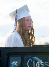Palmerton graduate, Kayla Cincilla pokes her head out of a Jeep during Palmerton's graduation ceremony at Pocono Raceway.