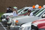 Graduates stand outside of their vehicles at the beginning of Weatherly's graduation ceremony.